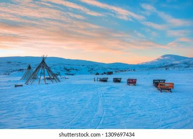 Traditional Sami reindeer skin tents at sunset - Tromso, Norway