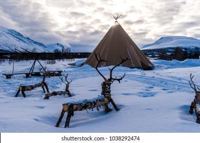 Traditional Sami reindeer-skin tents (lappish yurts) in Troms region of Norway.Tromso Lapland