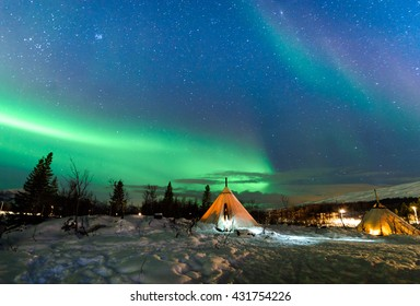 Traditional Sami reindeer-skin tents (lappish yurts) in Troms region of Norway .The polar lights in Norway .