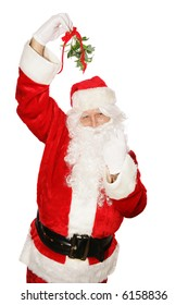 Traditional Santa Claus under the mistletoe motioning for you to come get a kiss.  Isolated on white.