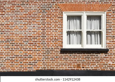 Traditional sash window and red brick wall background with copyspace