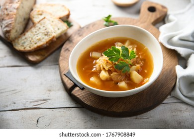 Traditional sauerkraut soup with fresh parsley