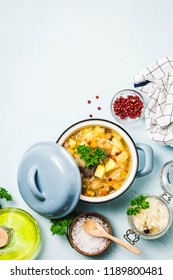 Traditional sauerkraut soup, shchi with meat and vegetables. Top view, space for text.