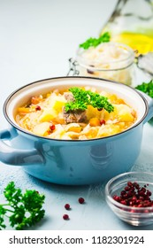Traditional sauerkraut soup, shchi in a pot. Top view, space for text.