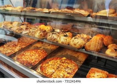 Traditional savoury pastry with filling. Fresh pastizzi and snacks for sale in a pastizzeria. Malta