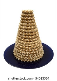 Traditional Scandinavian tower cake (kransekake) made from baked marzipan, decorated with icing