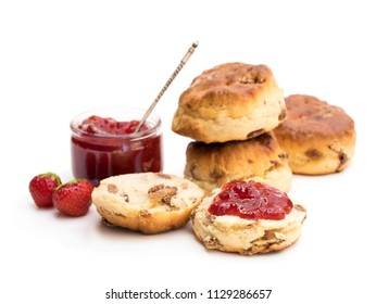 Traditional  scones with fresh strawberries and jam isolated on white