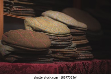 Traditional Scottish mens country tweed caps on display for sale.