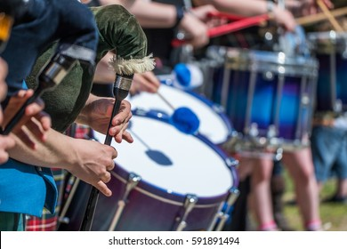 Traditional scottish pipe band in kilt at highland games