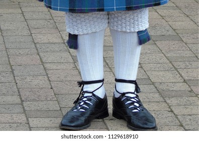 traditional scottish socks and shoes of a bagpiper