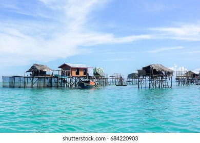 The traditional sea gypsy water village in Bodgaya Island in Tun Sakaran Marine Park,Semporna,Sabah,Borneo,Malaysia.Clear blue water & sandy beach.