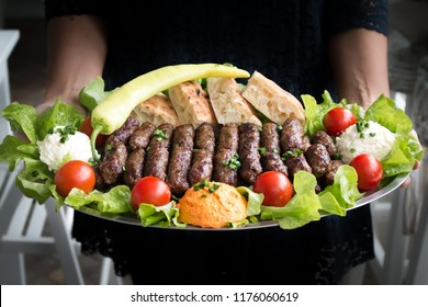 Traditional serbian food called cevapi made of minced meat and prepared on grill