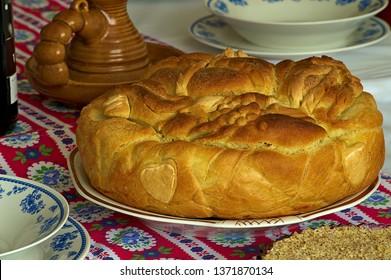 Traditional Serbian slava cake or slavski kolač with cooked wheat and red wine