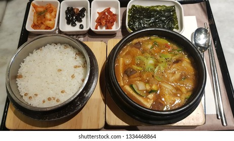 A traditional set of dishes in south korea-Soybean paste stew with mushrooms