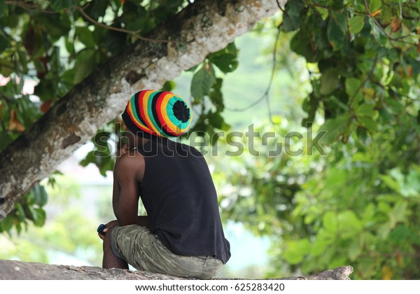 Traditional Seychelles mans cap. Rasta man with traditional stripes hat