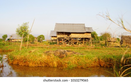 Traditional Shan house on stilts along a canal on Inle Lake Myanmar (Burma)