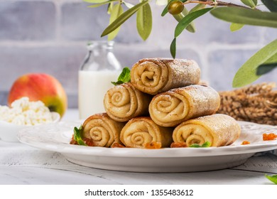 Traditional Shavuot Jewish holiday dish - blinches - thin pancakes with cottage cheese and raisins filling