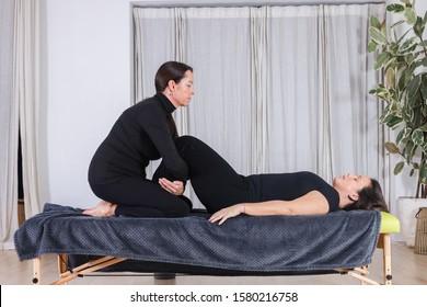 Traditional shiatsu massage done by mature therapist.