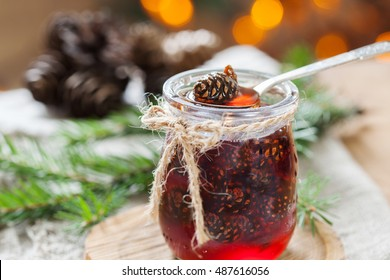 Traditional Siberian dessert confiture from young pine cones, honey jam with bokeh background