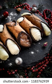 Traditional Sicilian cannoli served on the table,selective focus and Christmas decoration