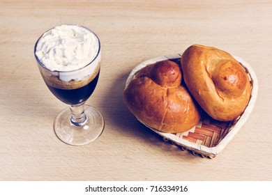 Traditional Sicilian Granita with Coffee and Cream and Two Brioches.