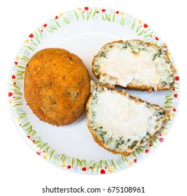 traditional sicilian street food - top view of spinach and sauce stuffed rice balls arancini on plate isolated on white background
