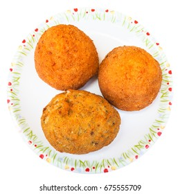 traditional sicilian street food - top view of various rice balls arancini on plate isolated on white background