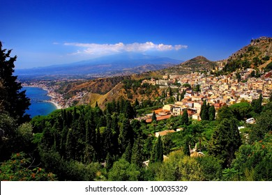 traditional Sicilian village Taormina with view on Etna volcano
