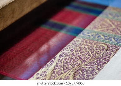 Traditional silk weaving loom. Royal brocade is produced using golden and silver threads