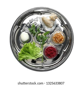 Traditional silver plate with symbolic meal for Passover (Pesach) Seder on white background, top view