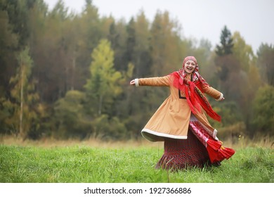Traditional Slavic rituals in the rustic style. Outdoor in summer. Slavic village farm. Peasants in elegant robes.