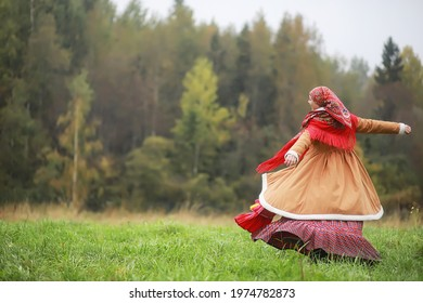 Traditional Slavic rituals in the rustic style. Outdoor in summer. Slavic village farm. Peasants in elegant robes. - Shutterstock ID 1974782873