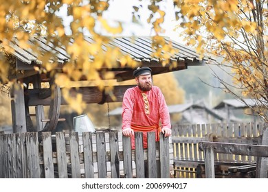 Traditional Slavic rituals in the rustic style. Outdoor in summer. Slavic village farm. Peasants in elegant robes. - Shutterstock ID 2006994017