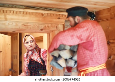 Traditional Slavic rituals in the rustic style. Outdoor in summer. Slavic village farm. Peasants in elegant robes. - Shutterstock ID 2006994026