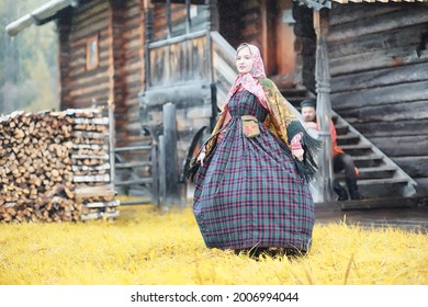 Traditional Slavic rituals in the rustic style. Outdoor in summer. Slavic village farm. Peasants in elegant robes. - Shutterstock ID 2006994044