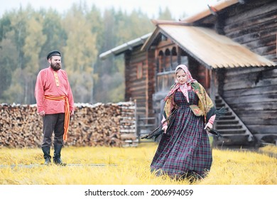 Traditional Slavic rituals in the rustic style. Outdoor in summer. Slavic village farm. Peasants in elegant robes. - Shutterstock ID 2006994059