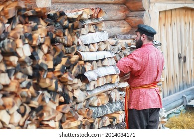 Traditional Slavic rituals in the rustic style. Outdoor in summer. Slavic village farm. Peasants in elegant robes. - Shutterstock ID 2014034171