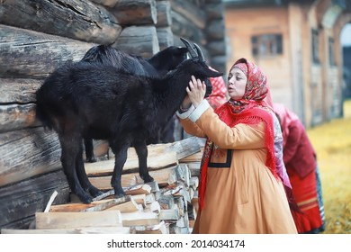 Traditional Slavic rituals in the rustic style. Outdoor in summer. Slavic village farm. Peasants in elegant robes. - Shutterstock ID 2014034174