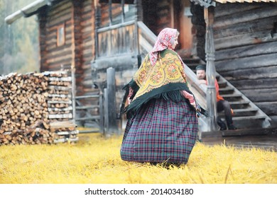 Traditional Slavic rituals in the rustic style. Outdoor in summer. Slavic village farm. Peasants in elegant robes. - Shutterstock ID 2014034180