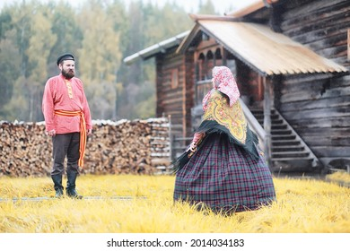 Traditional Slavic rituals in the rustic style. Outdoor in summer. Slavic village farm. Peasants in elegant robes. - Shutterstock ID 2014034183