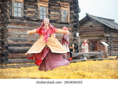 Traditional Slavic rituals in the rustic style. Outdoor in summer. Slavic village farm. Peasants in elegant robes. - Shutterstock ID 2014034192