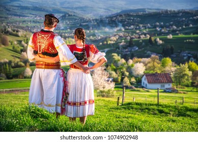 Traditional Slovak folk dress. Couple together in spring nature