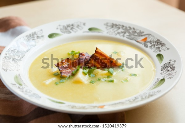 Traditional slovak sheep cheese soup with bacon and potatoes. Demikat.