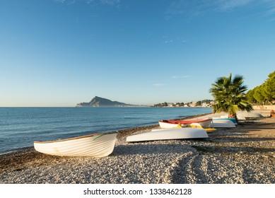 Traditional small fishing boats resting ashore, Altea bay, Costa Blanca, Alicante, Spain .