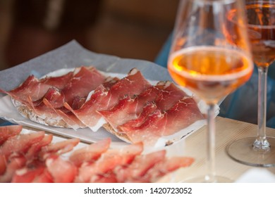 """Traditional smoked speck sliced on site during the """"Speckfest"""" celebration in Val di Funes, Dolomites."""