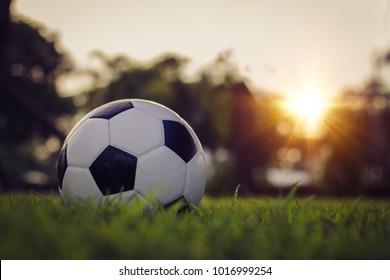 Traditional soccer ball on soccer field
