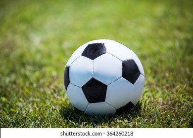 Traditional soccer ball on the lawn