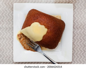 Traditional South African Malva pudding with custard