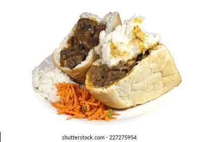 traditional south african mutton bunny chows with carrot and coriander sambal