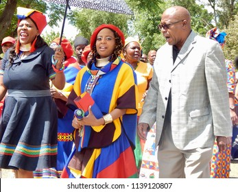 Traditional South African Wedding Between, Xhosa and Ndebele - Johannesburg, South Africa, 29 October 2017. Bride being accompanied by uncle and sister.